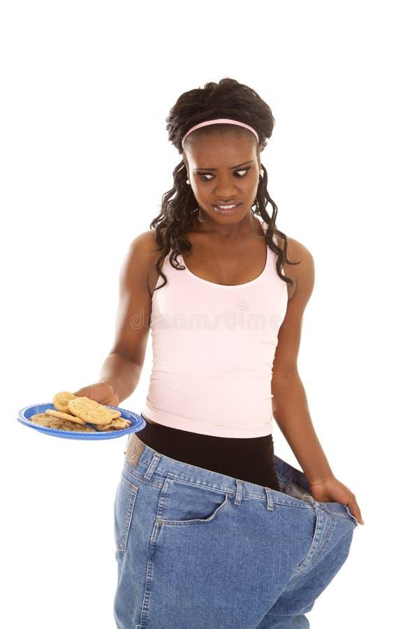 Dos bolinhos perdidos do peso da mulher calças grandes imagens de stock