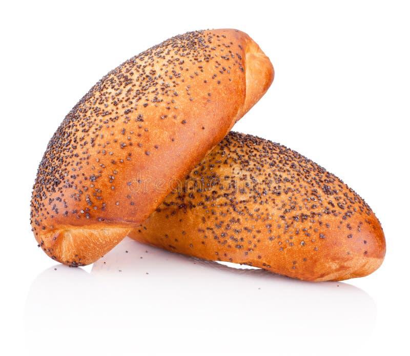 Dos bollos con las semillas de amapola en el fondo blanco fotografía de archivo libre de regalías
