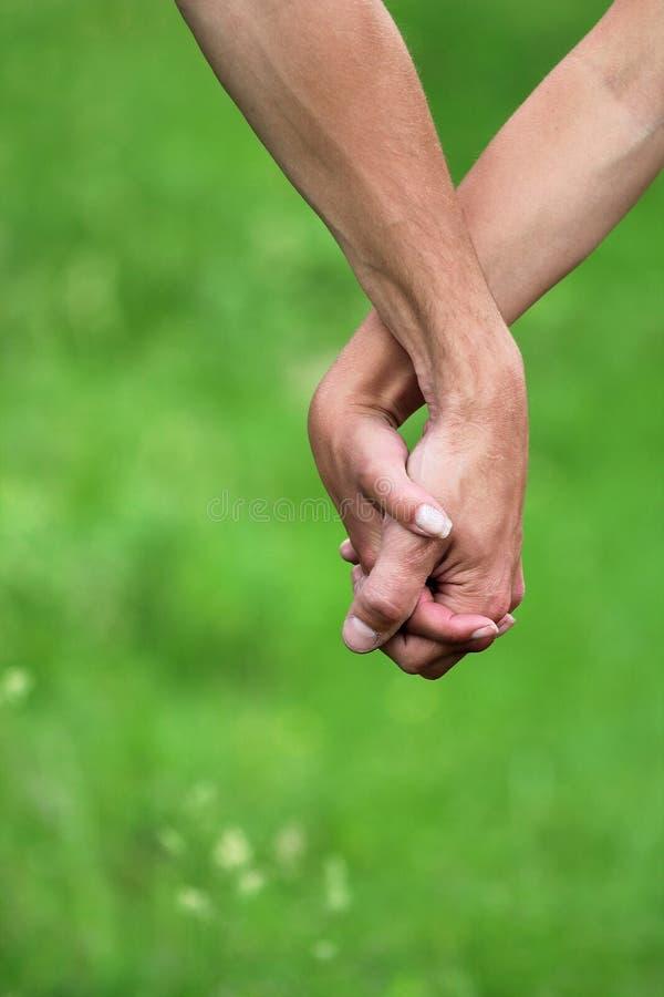 Dos brazos de amantes imagen de archivo libre de regalías