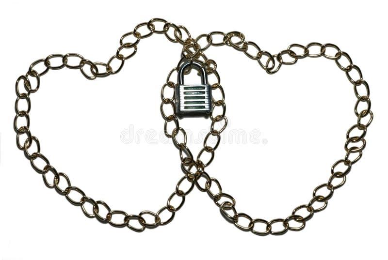 Dos cadenas separadas en formas del corazón cerradas en el centro imágenes de archivo libres de regalías