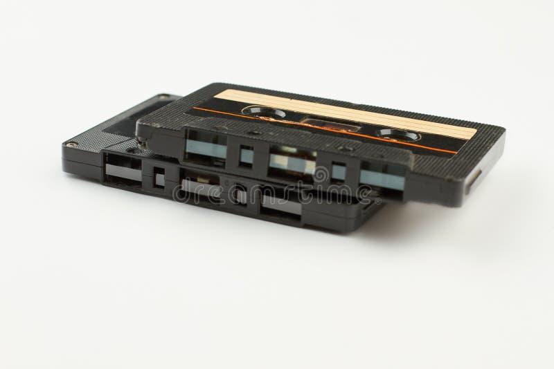 Dos casetes retros en el fondo blanco fotos de archivo