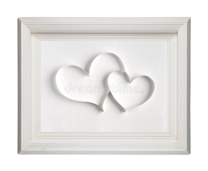 Dos corazones de papel en marco foto de archivo libre de regalías