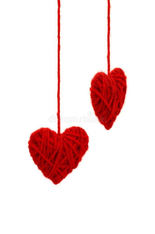 Dos corazones hechos punto fotografía de archivo