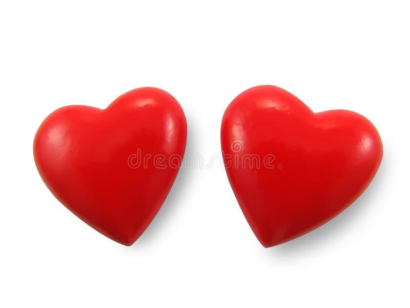 Dos corazones rojos. imagen de archivo