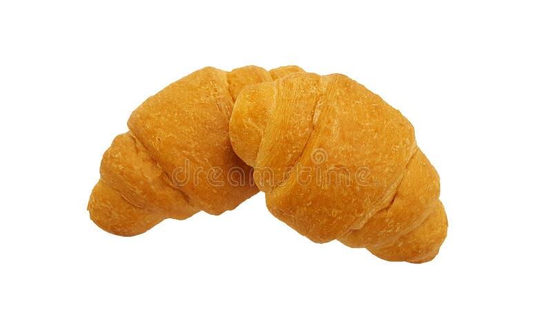 Dos croissants frescos en blanco foto de archivo libre de regalías
