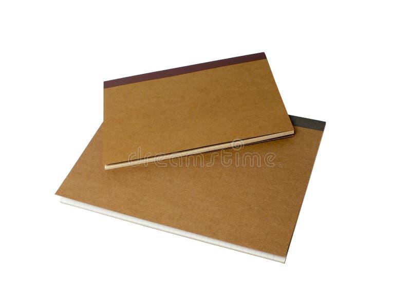 Dos cuadernos marrones aislados fotos de archivo libres de regalías