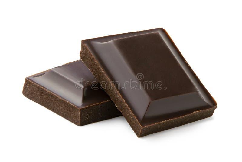 Dos cuadrados de chocolate oscuro aislados en blanco imagenes de archivo