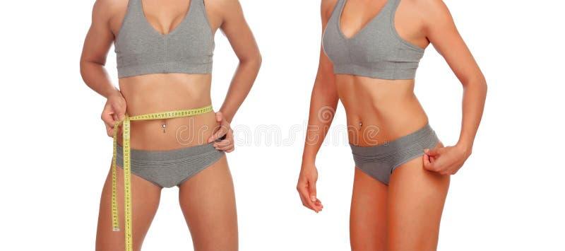 Dos cuerpos femeninos con cinta métrica en ropa interior fotos de archivo libres de regalías