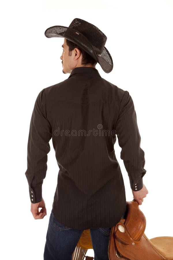 Dos de cowboy avec la selle images stock