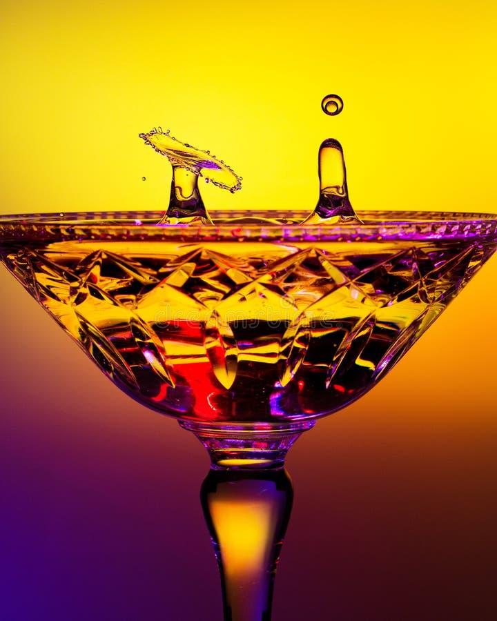 Dos descensos del agua en Crystal Champagne Glass foto de archivo libre de regalías