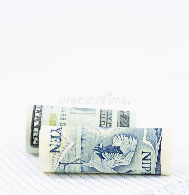 Dos dinero en circulación, dólares y Yenes foto de archivo libre de regalías