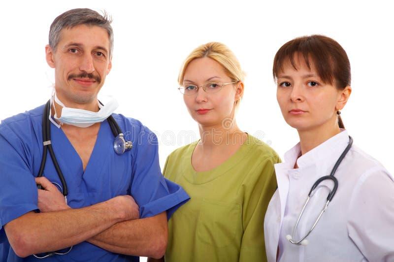 Dos doctores y enfermera foto de archivo