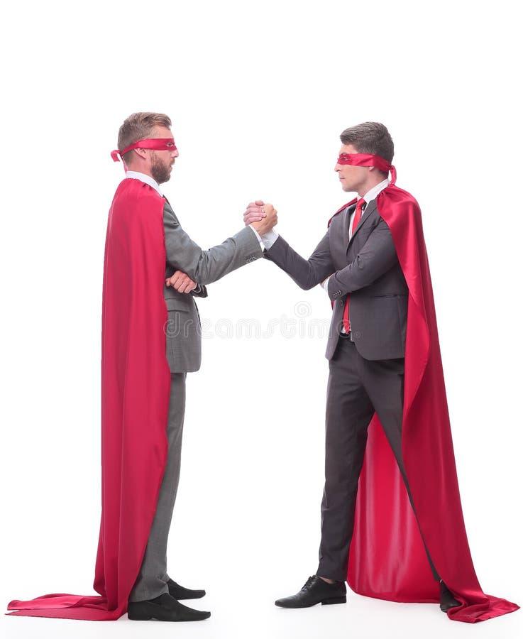 Dos empresarios del competidor en Superman capes fotos de archivo