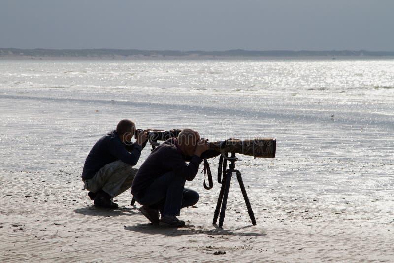 Dos fotógrafos fotos de archivo