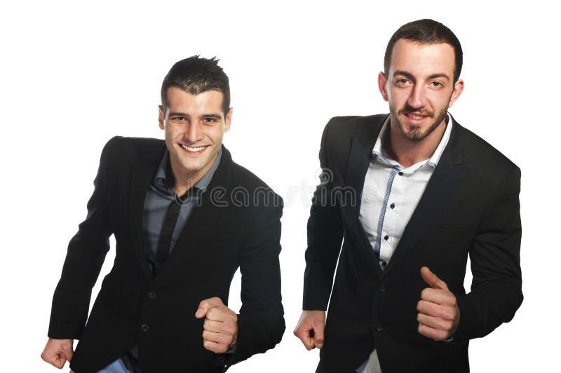 Dos funcionamientos del hombre de negocios de los jóvenes feliz imágenes de archivo libres de regalías