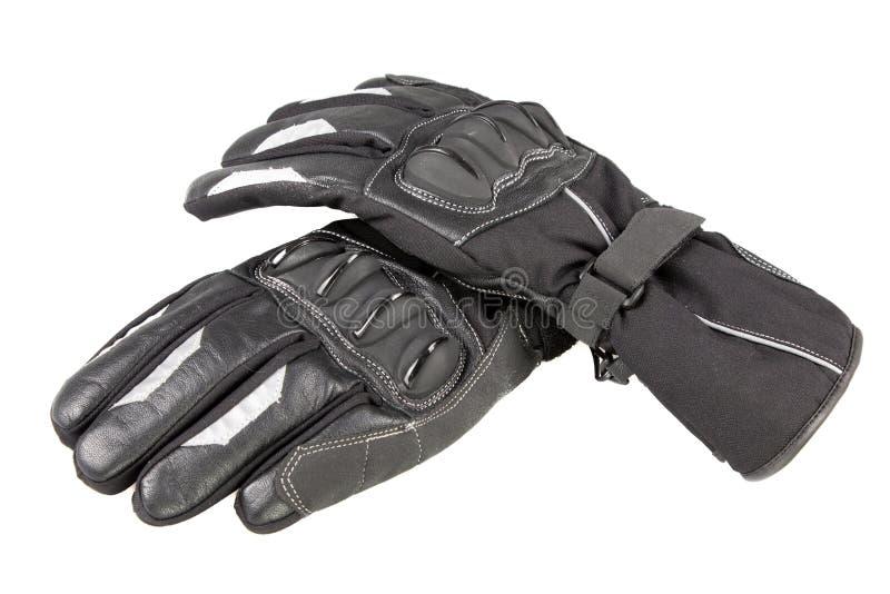 Dos guantes de la motocicleta negros para el motorista en el fondo blanco fotografía de archivo