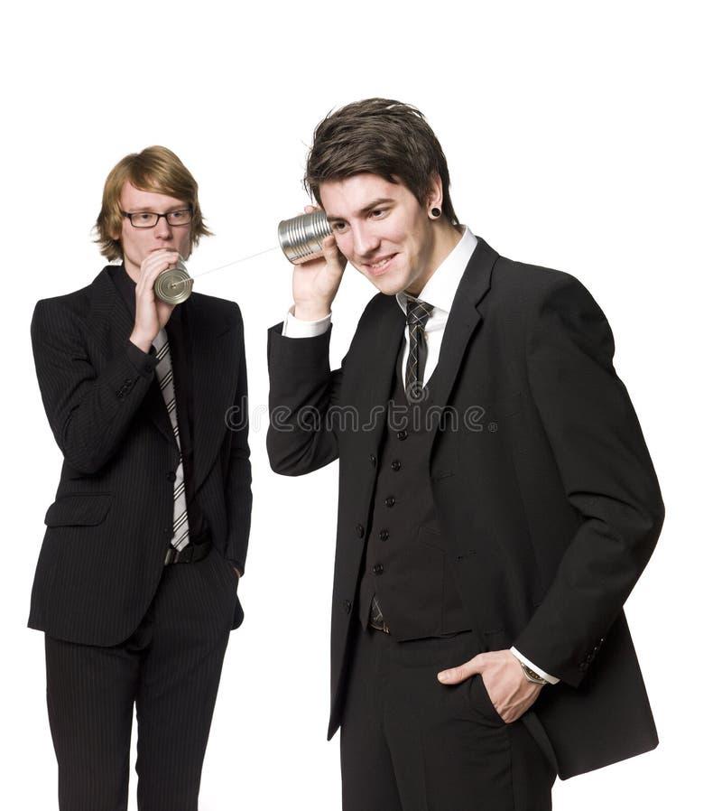 Dos hombres comunican fotografía de archivo libre de regalías
