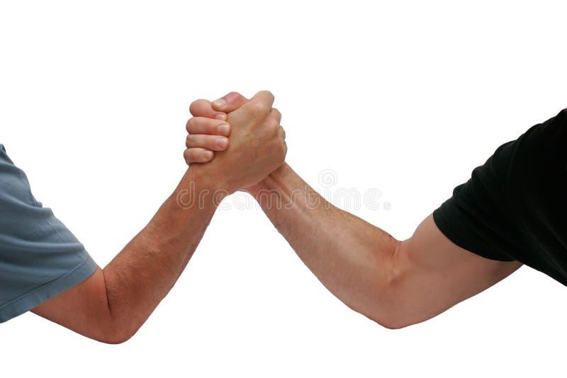 Dos hombres de las manos que luchan foto de archivo libre de regalías