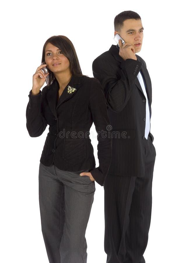 Dos hombres de negocios en los teléfonos celulares fotografía de archivo libre de regalías