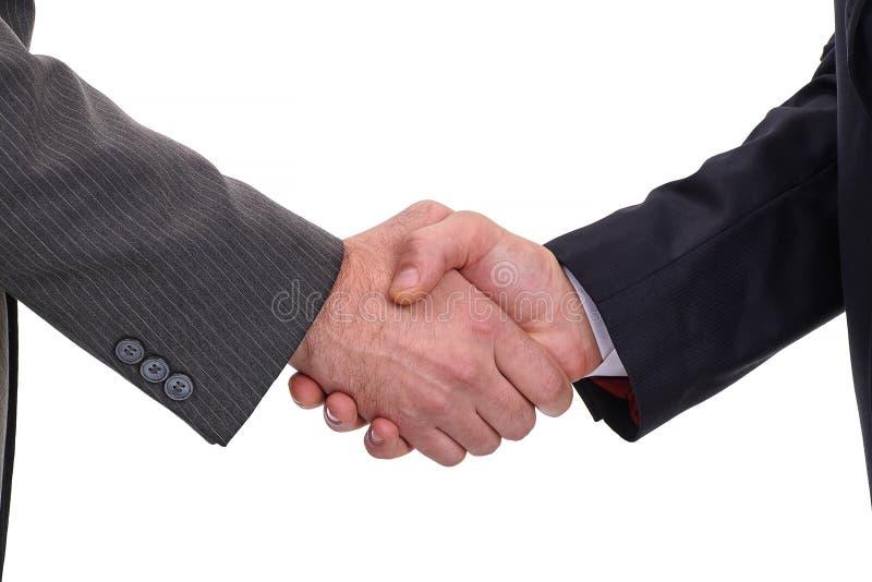 Dos hombres de negocios que sacuden las manos con un apretón de manos firme, aislado encendido foto de archivo libre de regalías