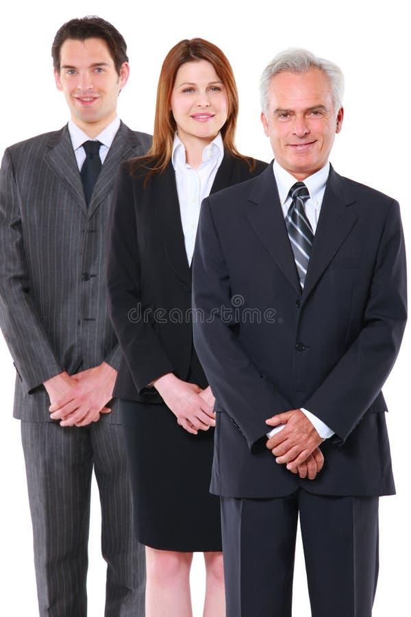 Dos hombres de negocios y una empresaria fotografía de archivo libre de regalías
