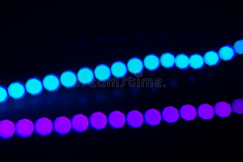 Dos líneas de neón del duotone de luces del bokeh en negro Fondo abstracto para su dise?o foto de archivo libre de regalías