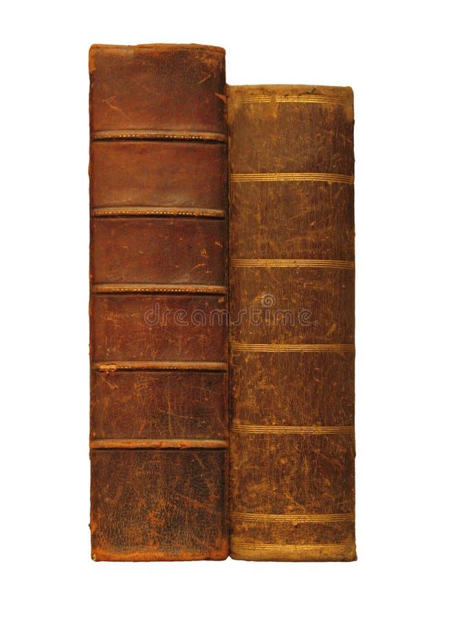 Dos libros antiguos, aislados en blanco foto de archivo