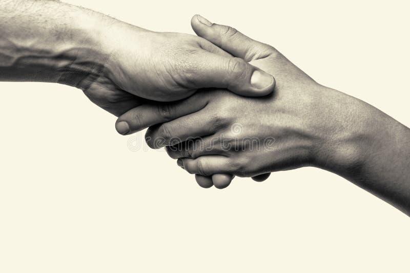 Dos manos - ayuda fotos de archivo