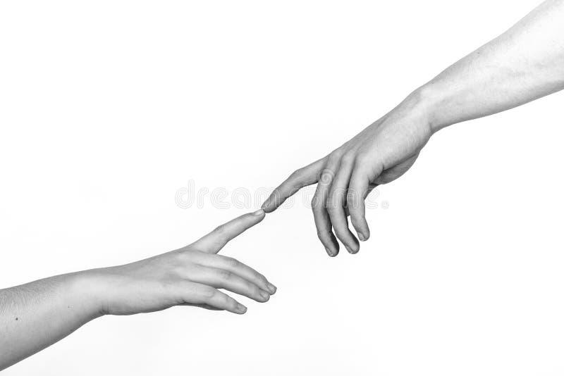 Dos manos en un fondo ligero, una reproducción del diagrama de la creación de Miguel Ángel de Adán foto de archivo libre de regalías