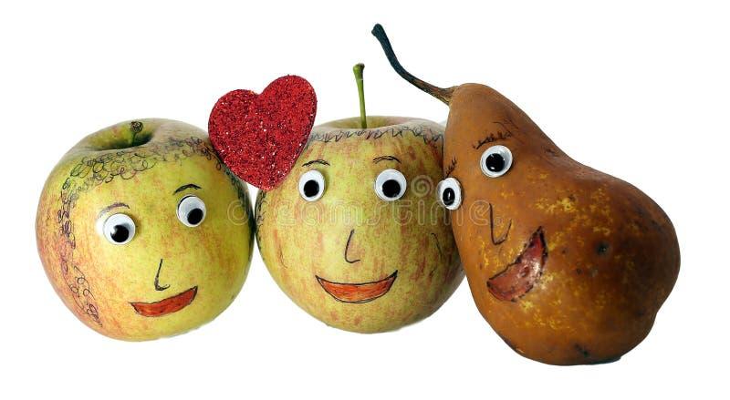 Dos manzanas con el corazón y una PERA foto de archivo libre de regalías