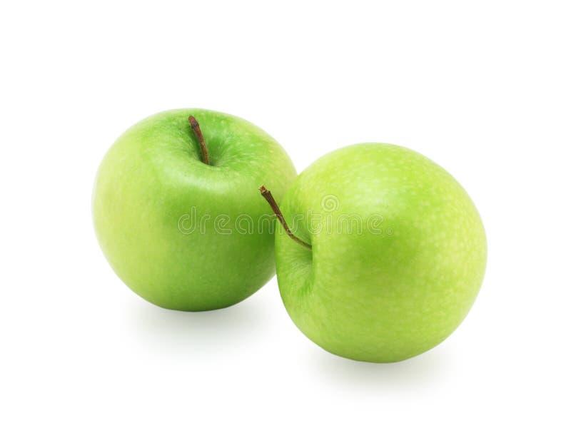 Dos manzanas verdes imagenes de archivo