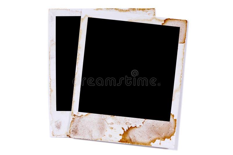Dos marcos polaroid manchados viejo vintage de la impresión de la foto del espacio en blanco del estilo imagenes de archivo