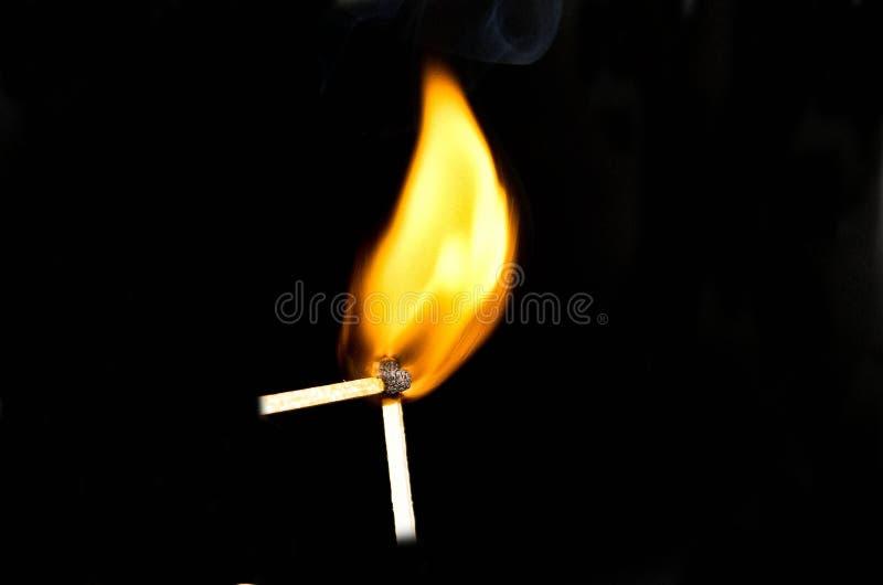 Dos matchsticks ardientes imagen de archivo libre de regalías