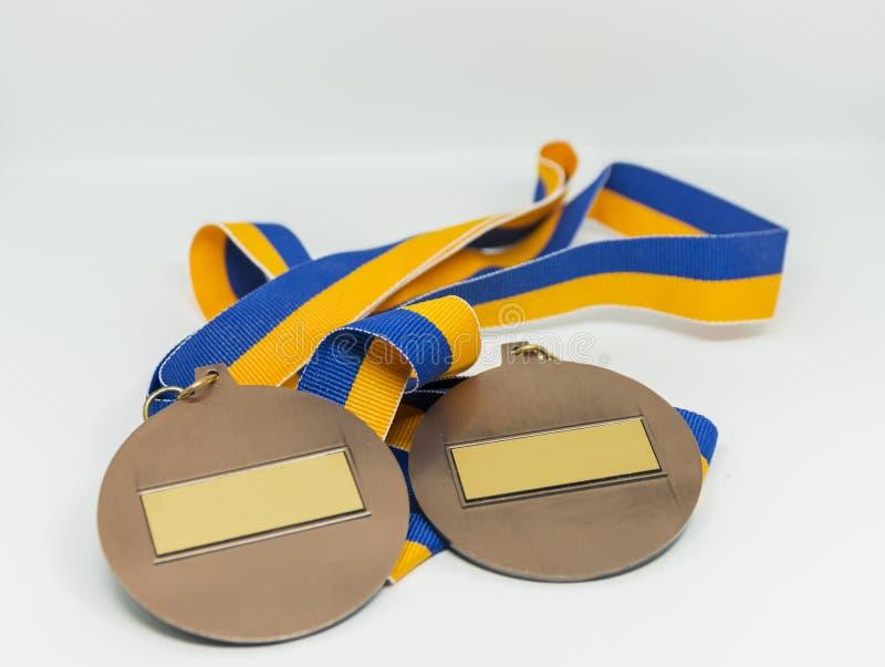 Dos medallas con las cintas del azul y del oro fotografía de archivo
