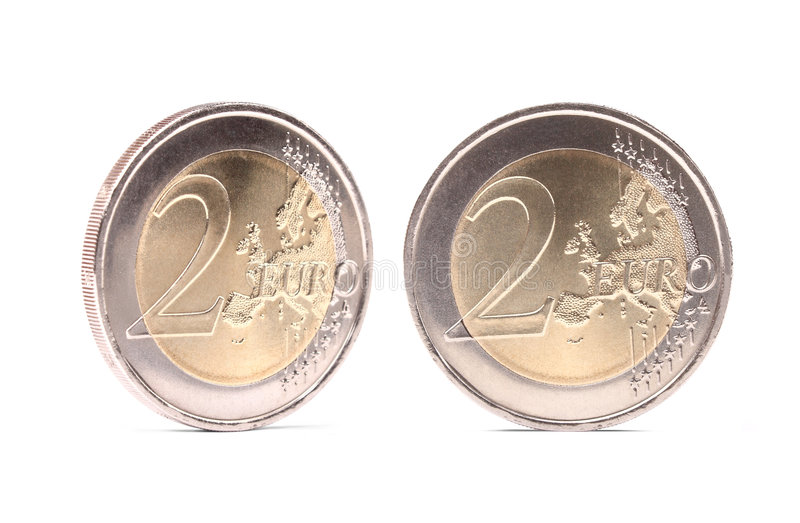 Dos monedas de los euros con las sombras fotografía de archivo libre de regalías