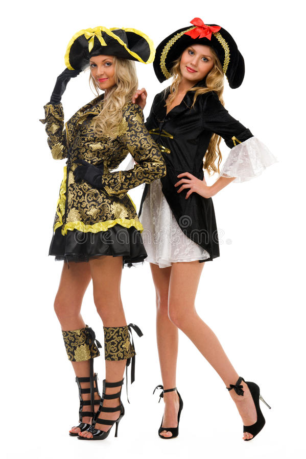 Dos mujeres en trajes del carnaval. Pirata y emperatriz fotografía de archivo libre de regalías