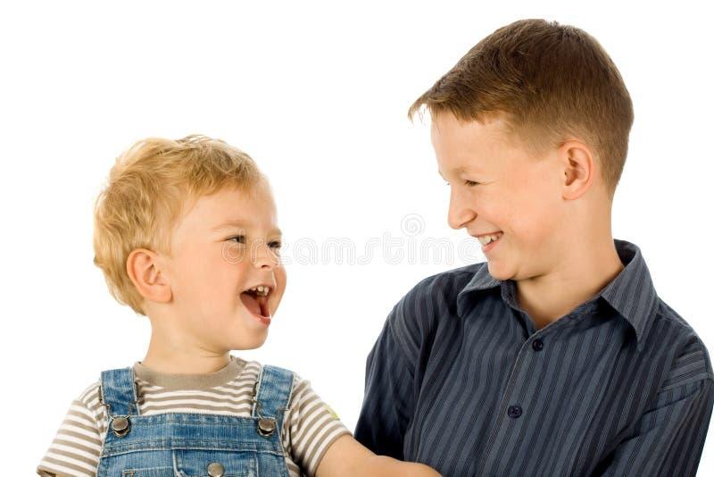 Dos niños felices fotografía de archivo