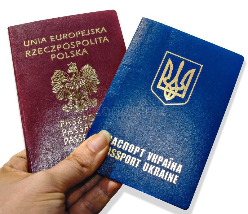 Dos pasaportes en la mano imágenes de archivo libres de regalías