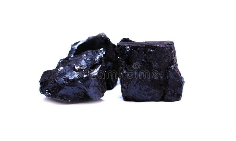 Dos pedazos de carbón de antracita en blanco El carbón es uno la mayoría foto de archivo libre de regalías