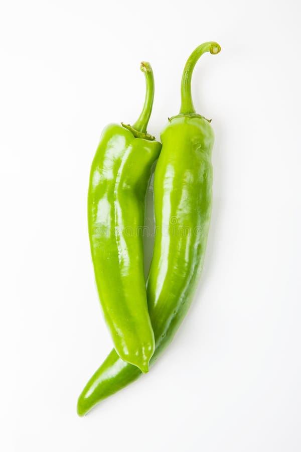 Dos pimientas verdes fotografía de archivo