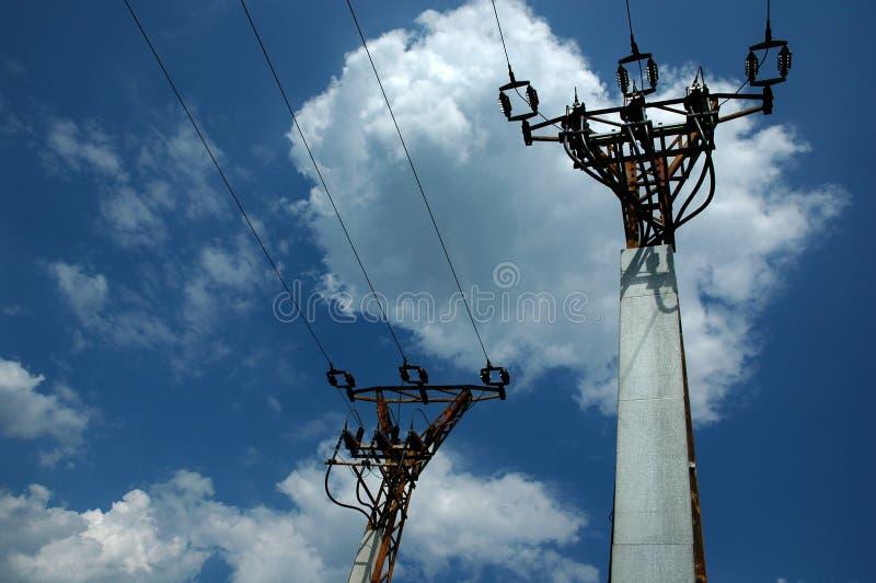 Dos postes eléctricos imagenes de archivo
