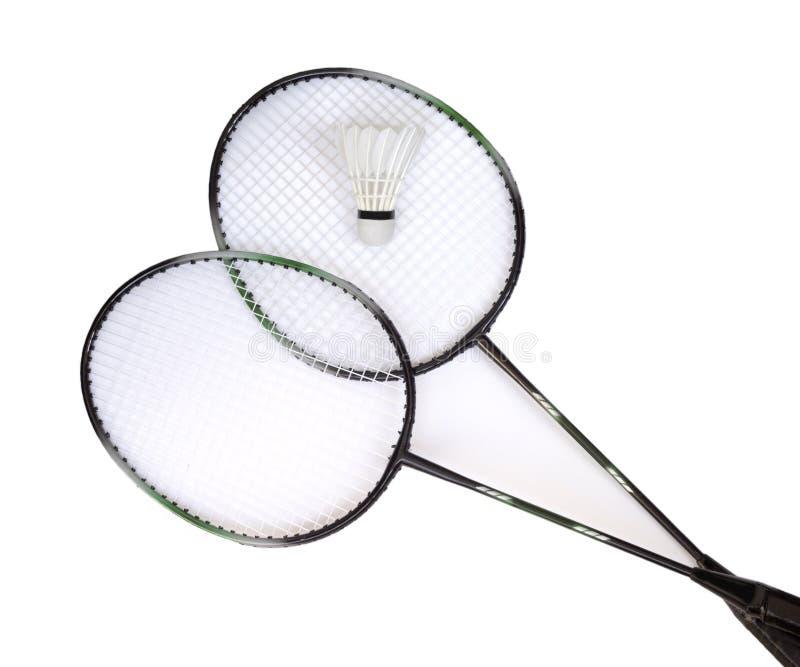 Dos raquetas de bádminton con el shuttlecock blanco fotografía de archivo