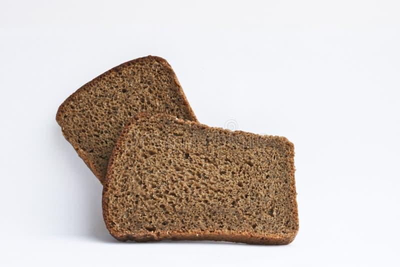 Dos rebanadas de pan de centeno oscuro Pan ácimo áspero fotografía de archivo