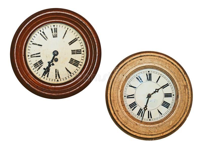 Dos relojes de pared viejos fotografía de archivo