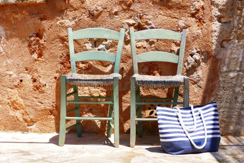 Download Dos sillas foto de archivo. Imagen de bolso, rayado, piedra - 64210384