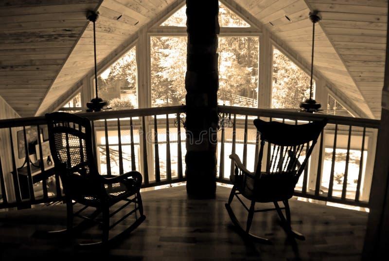 Dos sillas de oscilación en sepia fotos de archivo libres de regalías