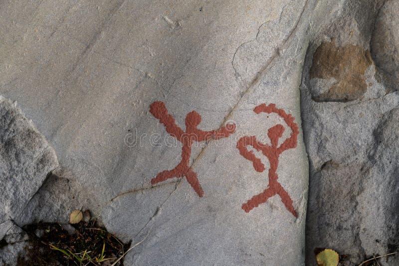 Dos tallas de la roca de los cazadores imagen de archivo libre de regalías