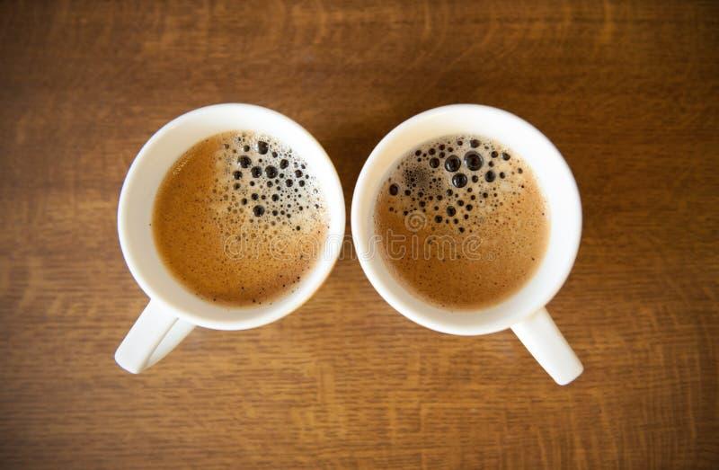 Dos tazas del whte con café express imágenes de archivo libres de regalías