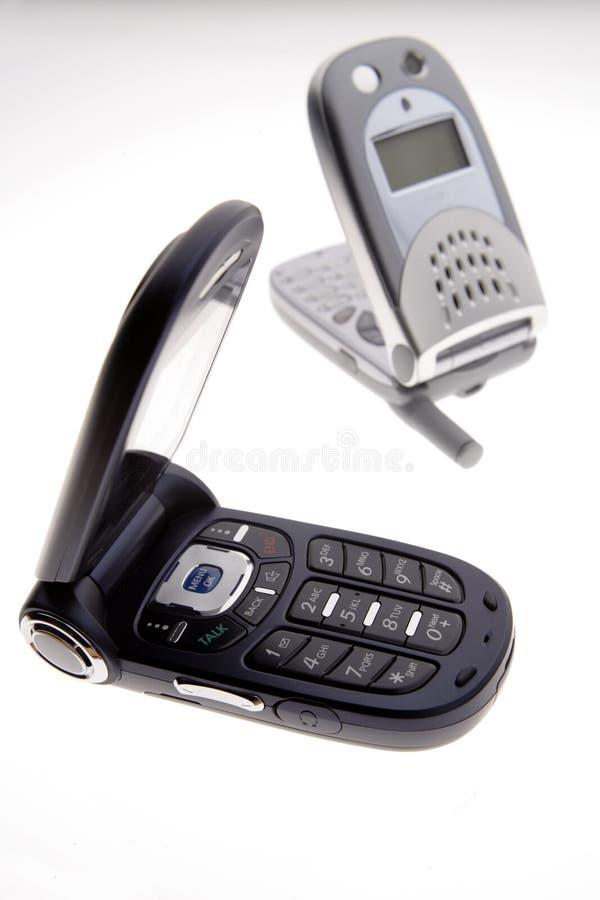 Dos teléfonos celulares aislados imágenes de archivo libres de regalías