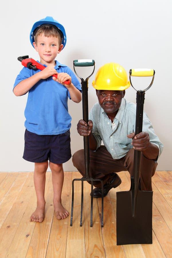Dos trabajadores de construcción fotografía de archivo libre de regalías